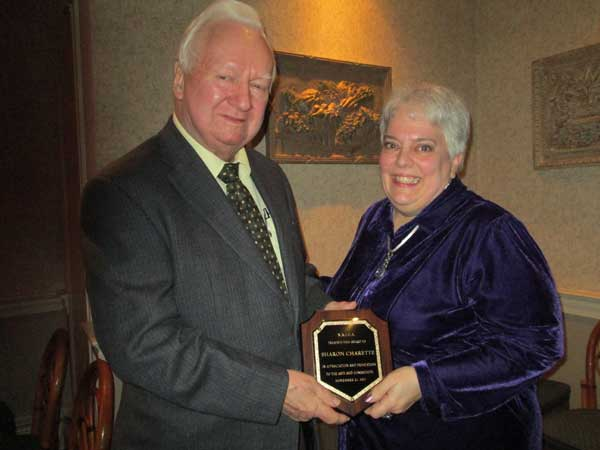 Sharon Charette Receives Award from Ray Nolan